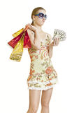 Woman with shopping bags and money Stock Photo