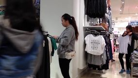 Shopper inside Forever 21 store to buying clothes stock video footage