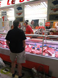 Shopper  inspects the butcher shop Royalty Free Stock Photography