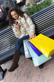 Shopper With Mobile Phone Royalty Free Stock Photo