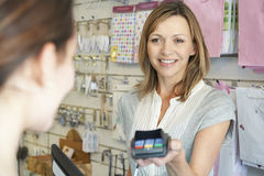 Shopper Paying For Goods Using Credit Card Machine Royalty Free Stock Photo