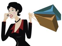 Shopper on the phone. Businesswoman talking on the cellphone with shopping bags Royalty Free Stock Photography