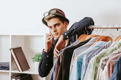 Shopper with the phone. Personal shopper with the phone in the textile workshop stock photo