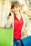 Shopper phoning Royalty Free Stock Photos