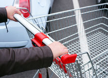 Shopper pushing empty cart Royalty Free Stock Photography