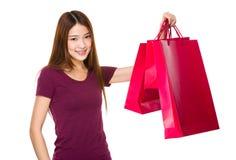 Shopper raise the shopping bag up Stock Image