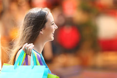 Shopper shopping walking on the street. Side view portrait of a happy shopper shopping walking on the street stock images