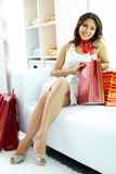 Shopper on sofa Royalty Free Stock Images