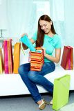 Shopper on sofa Royalty Free Stock Photos