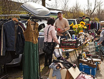 Shopper speaks with seller at  flea market  stall Royalty Free Stock Image