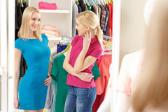Shopper speaks to shop stylist in a store Royalty Free Stock Photography