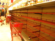 Shopper staring at empty shelves in NY grocery Stock Images