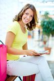 Shopper with touchpad Royalty Free Stock Photos