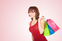 Shopper Walking With Colourful Carrier Bags Royalty Free Stock Photos