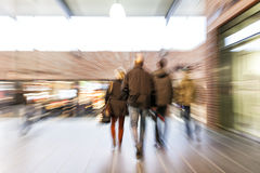 Shopper walking through corridor, zoom effect, motion blur Stock Images