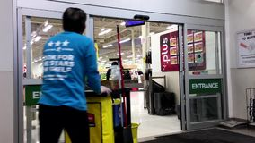 Shopper walking through the main entrance at superstore stock video