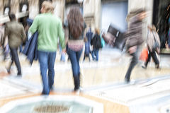 Shopper walking past a store window, zoom effect, motion blur Royalty Free Stock Photography
