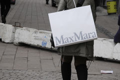 SHOPPER WIH MAXMARA SHOPPING BAG Stock Photo