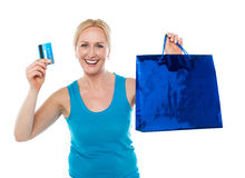 Shopper woman holding bag and credit card Royalty Free Stock Image