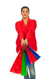 Shopper woman offering bags Royalty Free Stock Photos