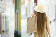 Shopper woman in shopping centre. Back view Royalty Free Stock Photography