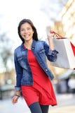 Shopper - woman shopping outside Royalty Free Stock Photography