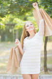Shopper woman walking and shopping Royalty Free Stock Photography
