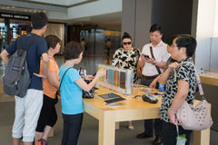 Shoppers in Apple store Stock Photography