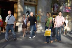 Shoppers with bags on Passeig de Gr�cia in the Eixample district, busy street in Barcelona, Spain, Europe Royalty Free Stock Photo