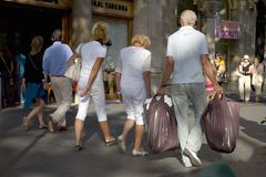 Shoppers with bags on Passeig de Gr�cia in the Eixample district, busy street in Barcelona, Spain, Europe Royalty Free Stock Image