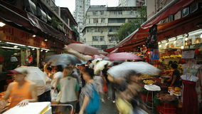 Shoppers browse the traditional chinese stalls in wanchai market hong kong stock video