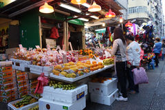 Shoppers buy fruits at Kowloon City Market in Hong Kong Stock Photo