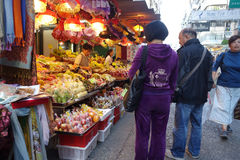 Shoppers buy fruits at Kowloon City Market in Hong Kong Royalty Free Stock Photo