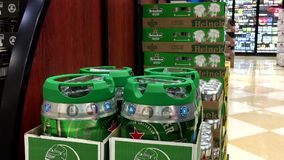 Shoppers buying Heineken beer stock footage