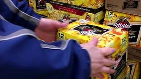 Shoppers buying Miller beer. stock video