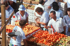 Shoppers buying produce at an open air market Stock Photography