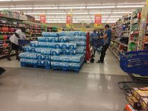 Shoppers buying water before hurricane Florence. Shoppers stocking up on water and other supplies before hurricane Florence. Grocery store employee in Sneads stock photo