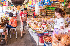 Shoppers buys dried seafood. Stock Image