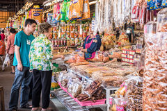 Shoppers buys dried seafood. Stock Images