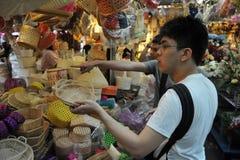 Shoppers at Chatuchak Market in Bangkok