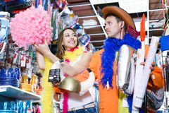 Shoppers choose holiday accessories for a party. Young shoppers choose holiday accessories for a party in the store Royalty Free Stock Image