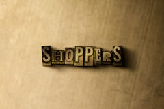 SHOPPERS - close-up of grungy vintage typeset word on metal backdrop. Royalty free stock - 3D rendered stock image.  Can be used for online banner ads and Royalty Free Stock Photo