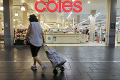 Shoppers in Coles Supermarket in Brisbane Queensland Australia. Hoppers in Coles Supermarket.Coles has over 100,000 employees and, together with rival Woolworths stock photo