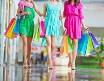 Shoppers in dresses Stock Photos