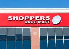 Shoppers Drug Mart Sign in Toronto. Shoppers drug mart sign; Shoppers Drug Mart Corporation is Canada's largest retail pharmacy chain and it was bought recently Royalty Free Stock Photo