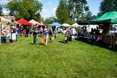 Farmers Market in Courtenay, British Columbia Canada. Shoppers enjoying the day at the local Farmers Market in Courtenay on Vancouver Island, British Columbia Stock Image