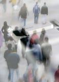 Shoppers escape. Crowd of shoppers overlaid onto escape key Stock Photo