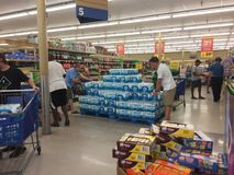 Shoppers buying supplies before hurricane Florence. Shoppers at a grocery store in Sneads Ferry North Carolina stocking up on water and other supplies days royalty free stock photography