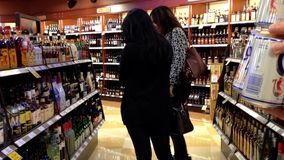 Shoppers inside BC liquor store stock footage