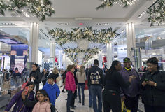 Shoppers inside Macy's at Christmas time in NYC Royalty Free Stock Images